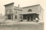 Post Office. Porter's Barber Shop, Wood's Shoe & Harness Shop circa 1920s